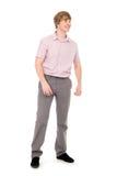 Retrato de un hombre joven que se coloca integral. Imagen de archivo