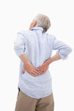 Retrato de un hombre que tiene un dolor de espalda Imagenes de archivo