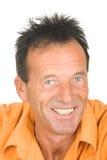 Retrato de un hombre sonriente envejecido medio fotos de archivo libres de regalías