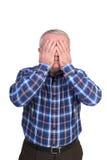 Retrato de un hombre triste que cubre su cara con las manos Fotografía de archivo