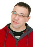 Retrato de un individuo con los vidrios en una alineada roja Fotos de archivo