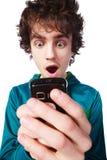 Retrato de un individuo hermoso con un teléfono móvil Fotos de archivo libres de regalías