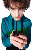 Retrato de un individuo hermoso con un teléfono móvil Imagen de archivo