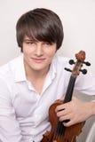 Retrato de un músico joven con un violín Fotografía de archivo
