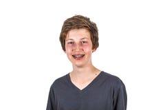 Retrato de un muchacho adolescente con los apoyos Fotografía de archivo libre de regalías