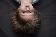 Retrato de un muchacho al revés Imágenes de archivo libres de regalías