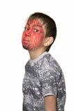 Retrato de un muchacho con la cara pintada Fotografía de archivo libre de regalías