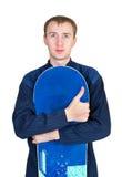 Retrato de un muchacho en ropa de deportes con el snowboard Fotografía de archivo
