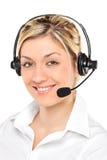 Retrato de un operador de sexo femenino del servicio de atención al cliente fotos de archivo libres de regalías