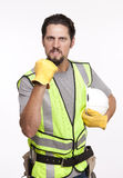 Retrato de un trabajador de construcción furioso con el puño apretado Imágenes de archivo libres de regalías