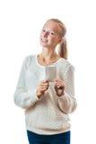 Retrato de una chica joven con la insignia fotos de archivo libres de regalías