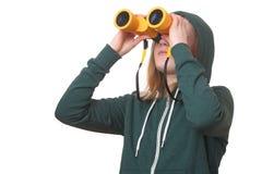 Muchacha con los prismáticos Fotografía de archivo libre de regalías