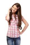 Retrato de una colegiala con el teléfono celular Foto de archivo libre de regalías