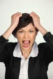 Retrato de una empresaria joven muy enojada Foto de archivo