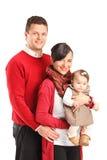 Retrato de una familia feliz joven con el cabrito Imágenes de archivo libres de regalías