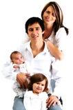 Retrato de una familia joven con sus niños Fotografía de archivo libre de regalías