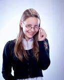 Retrato de una muchacha adolescente con los vidrios Foto de archivo