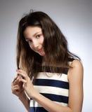 Retrato de una muchacha con el pelo marrón Fotografía de archivo libre de regalías