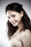 Retrato de una muchacha con el pelo marrón Fotografía de archivo