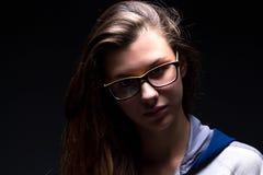 Retrato de una muchacha en sombra Imagen de archivo libre de regalías