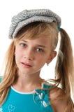 Retrato de una muchacha en un casquillo. imagenes de archivo