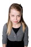 Retrato de una muchacha encantadora joven que mira de abajo hacia arriba Fotos de archivo libres de regalías