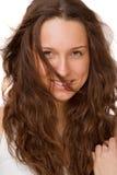 Retrato de una muchacha hermosa en un fondo blanco Fotos de archivo libres de regalías