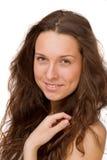 Retrato de una muchacha hermosa en un fondo blanco Imagen de archivo