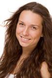 Retrato de una muchacha hermosa en un fondo blanco Imagen de archivo libre de regalías