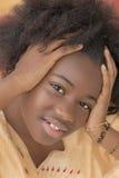 Retrato de una muchacha joven del Afro Imágenes de archivo libres de regalías
