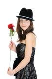 Retrato de una muchacha joven y hermosa con la rosa aislada en el fondo blanco Imagen de archivo libre de regalías