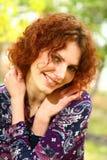 Retrato de una muchacha redheaded Foto de archivo libre de regalías