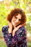 Retrato de una muchacha redheaded Imagen de archivo libre de regalías