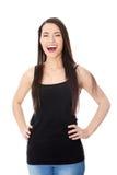 Retrato de una mujer adolescente joven feliz. Foto de archivo libre de regalías