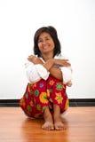 Retrato de una mujer asentada fotografía de archivo libre de regalías