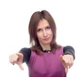 Mujer joven que señala ambas manos hacia Fotos de archivo