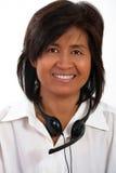 Retrato de una mujer con un receptor de cabeza fotos de archivo libres de regalías