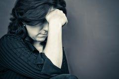 Retrato de una mujer deprimida Imágenes de archivo libres de regalías