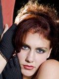 Retrato de una mujer dirigida roja joven Fotos de archivo