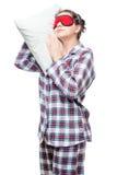 Retrato de una mujer durmiente en una almohada suave Fotos de archivo