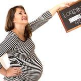 Retrato de una mujer embarazada con una muestra Foto de archivo