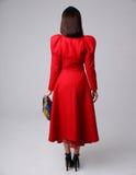 Retrato de una mujer en vestido rojo Foto de archivo