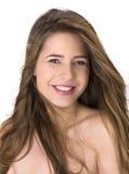 Retrato de una mujer joven con los pelos largos Foto de archivo libre de regalías