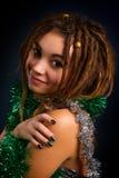Retrato de una mujer joven hermosa con los dreadlocks Imagen de archivo libre de regalías
