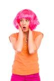 Retrato de una mujer joven que parece sorprendida. Fotos de archivo