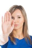 Retrato de una mujer que gesticula la muestra de la parada Foto de archivo