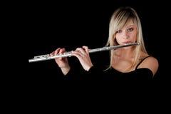 Retrato de una mujer que toca la flauta transversal Fotografía de archivo