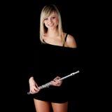 Retrato de una mujer que toca la flauta transversal Fotos de archivo libres de regalías