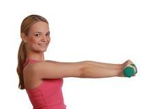 Mujer con pesas de gimnasia Imagen de archivo libre de regalías