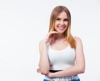 Retrato de una mujer sonriente joven Fotografía de archivo libre de regalías